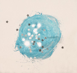 Silver glittering stars on abstract blue watercolor splash in vintage nostalgic colors.