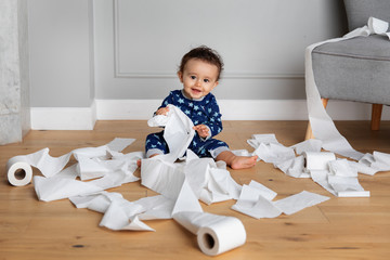 Cute baby playing with toilet paper