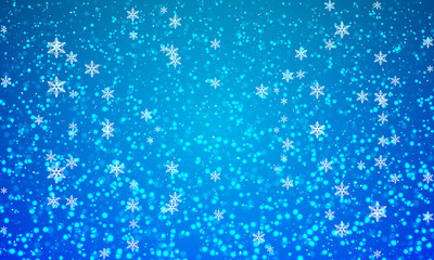 abstract blue bokeh background with snowflakes