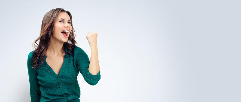 Happy gesturing businesswoman , on grey