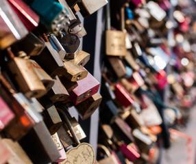 Many padlocks on the fence symbolizing love