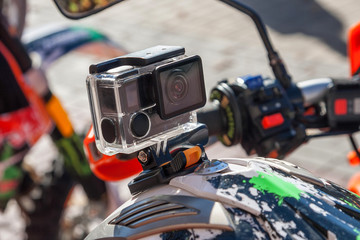 Action camera on a motorcycle rider's helmet.