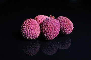 Litchi chinensis lychee sweet fruit on black background