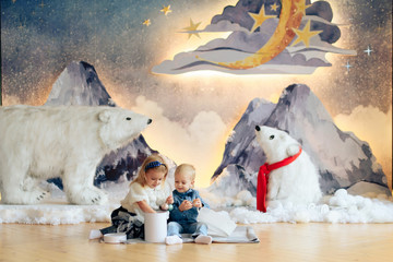 little boy and girl with Christmas decor, brother and sister for new year