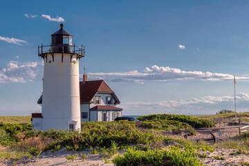 Race Point Light Lighthouse in sand dunes on the beach at Cape Cod, New England, Massachusetts, USA.