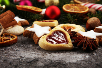 Decoration with christmas cookies. Typical cinnamon stars with fruits and nuts