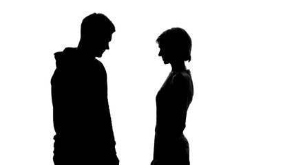Silhouettes of young male and female on white background looking at each other