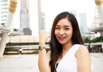 Beautiful Asia woman smile portrait on walking street.