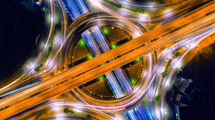 Spoed Foto op Canvas Nacht snelweg Aerial view of traffic in roundabout and highway at night.