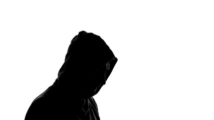 Silhouette of man wearing hoodie standing on white background, shadow, anonymous