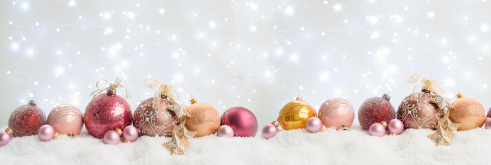 White christmas with snow - row of pink and golden decorations wide banner