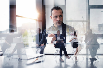 Business people connected on internet network with laptop and tablet. concept of startup company. double exposure