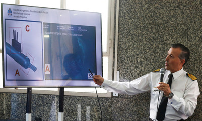 Argentina's Captain Balbi shows a drawing and picture of the ARA San Juan submarine during a news conference at Libertad Building in Buenos Aires