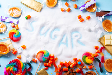Sweets with sugar, flat lay top view scene with word sugar