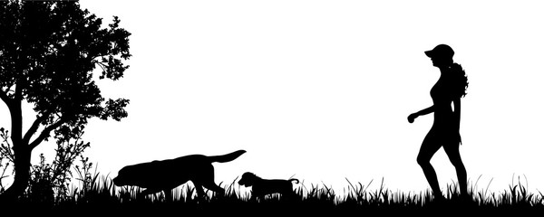 Vector silhouette of woman with dogs on the meadow.