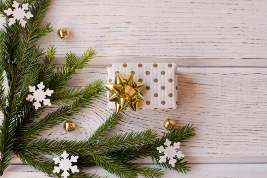 Gifts for the New year and Christmas on the wooden background