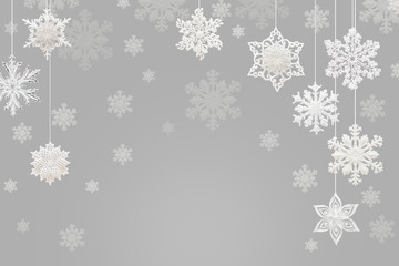 Christmas and New Year decorations: snowflakes on gray background.
