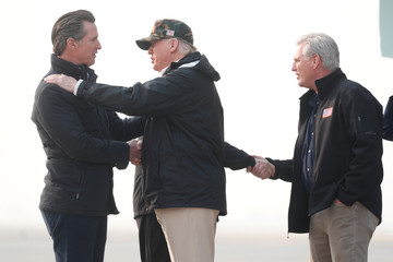 President Donald Trump shakes hands with Governor-elect Gavin Newsom as U.S. House Majority Leader Rep. Kevin McCarthy shakes hands with Governor Jerry Brown upon arriving at Beale Air Force Base California