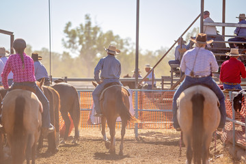 Cowboys On Horseback Watching Country Rodeo