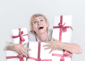 closeup.very happy woman with gift boxes. isolated on a white background