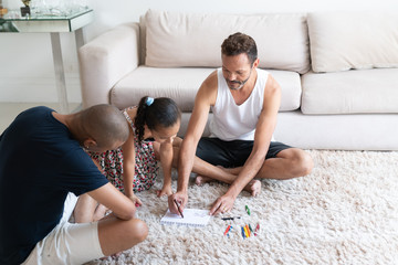 Gay Couple Helping her Daughter Doing Homework