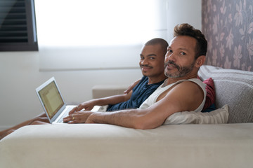 Gay Couple Using Laptop at Home Portrait
