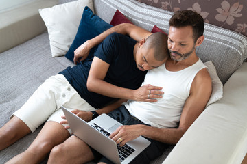 Gay Couple Using Laptop at Home
