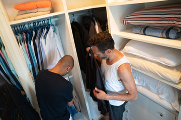 Mature Gay Couple Deciding which Shirt To Wear