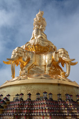 Giant golden Buddha statue on top of Emei Mountain in China