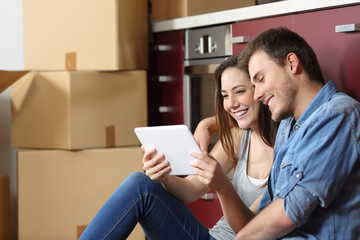 Couple buying online and moving home