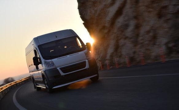 acceleration minibus on background sunset