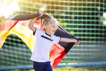 Germany football fan kids. Children play soccer.