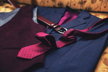 Man suit, tie, belt and jacket. Elegance and business man clothing.