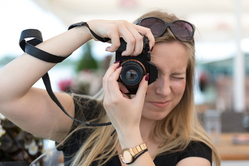 Girl making photo of me with a camera