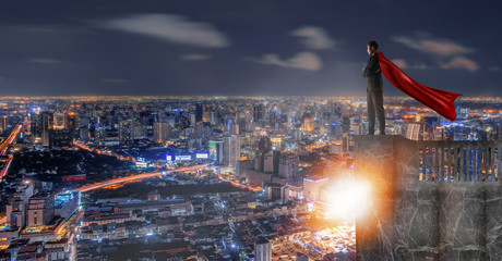 Businessman Standing on top, Looking cityscape view,Wide view of a businessman in the age of globalization.