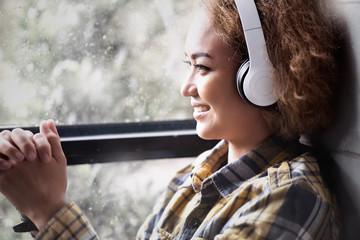 woman listening to music headphones having happy in Winter Season
