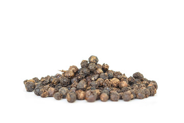 black peppercorns heap top view on white background.