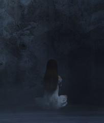 Woman sitting in a dark room,3d rendering