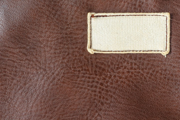 label white on leather brown.