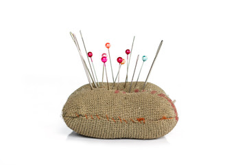 sewing pins on white background.