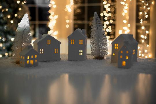 Ceramic tea light holder small houses Christmas background