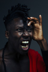 Fashion portrait of male African American screaming