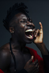 Portrait of a male African American screaming with a finger in his mouth