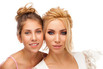 Closeup portrait of two sisters - isolated on white background