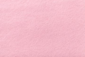 Light pink matt suede fabric closeup. Velvet texture of felt.