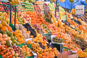 Arequipa, Peru - October 7, 2018: Fresh fruit and vegetable produce on sale in the central market, Mercado San Camilo