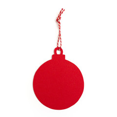 Red christmas ball gift tag with ribbon isolated on white background
