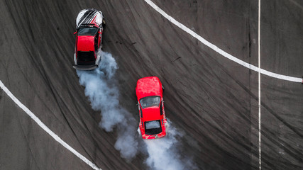 Aerial view drift battle, Two cars drift battle on race track with smoke. Fototapete