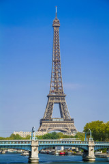 View of the famous Eiffel Tower in Paris France on a summer day with a clear blue sky with the Pont de Rouelle in the foreground and the iconic Eiffel Tower in the background