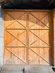 Old wooden doors. Warehouse entrance.